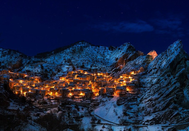 Lovely houses in the most beautiful snow-covered mountain hamlets in Italy